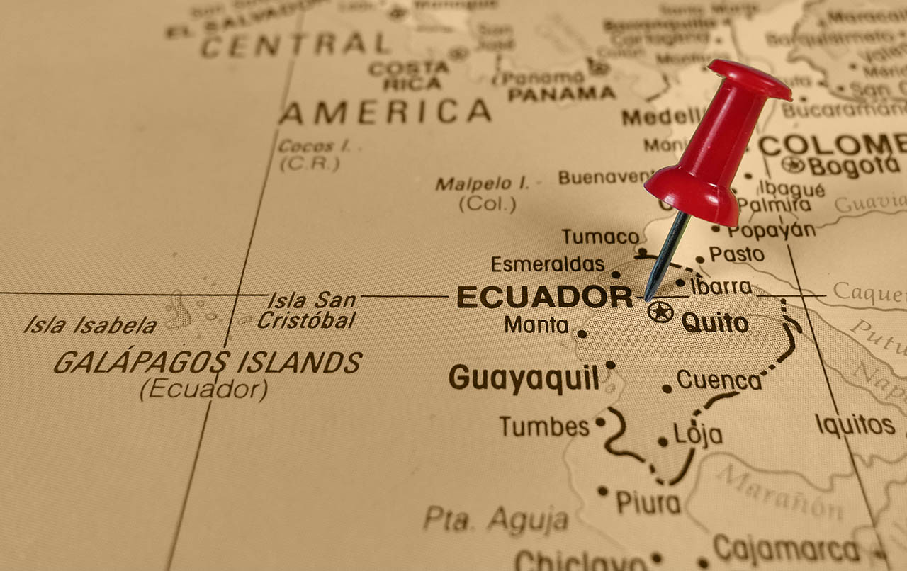 Ecuador map with red stick pin near the capital city of Quito