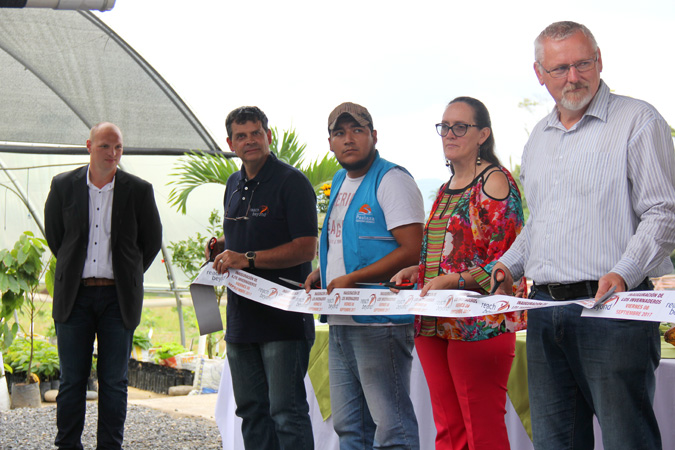 Set to cut the ribbon to inaugurate a greenhouse (l-r) Wim de Groen, Dan Shedd, Marco Adrian (Pastaza province engineer), Jessie Engelmann (Pastaza province president), Hermann Schirmacher.