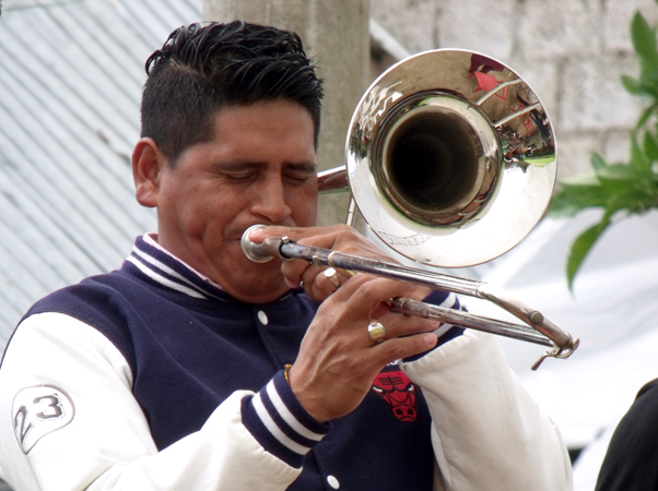 A trombone player was part of the local band that provided some of the entertainment at the project dedication.