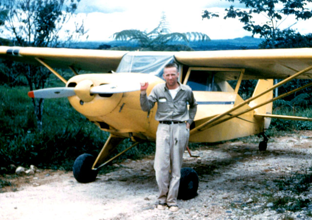 Nate Saint with the Piper aircraft that he used while flying as a missionary pilot in Ecuador. Photo courtesy of Mission Aviation Fellowship.