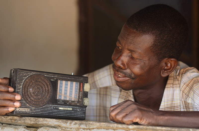 We believe in Radio! An African man listens to a FM radio station that Reach Beyond helped plant in Ghana.