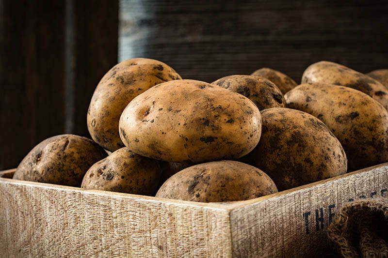 stock image of a box of potatoes