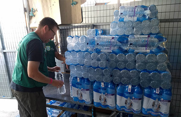More than 9,000 plastic water bottles are distributed every day in the Moria refugee camp.