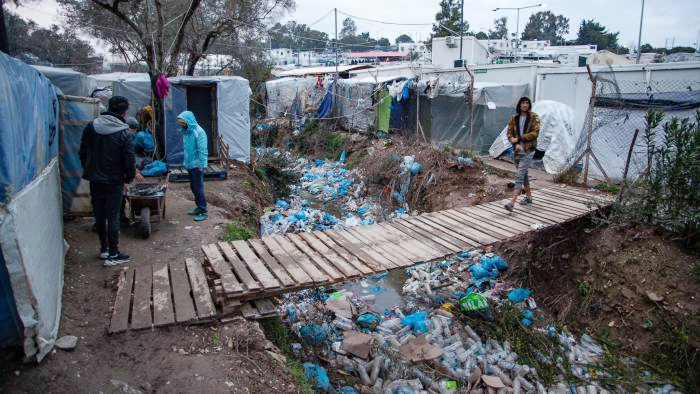 More than 9,000 plastic water bottles are distributed every day in the Moria refugee camp, and many end up discarded in the ravine. Reach Beyond's Trash to Treasure program aims to transform the plastic into useful items.