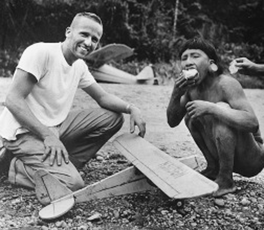 "Nate Saint, one of the five missionaries speared to death by Waorani warriors on Jan. 8, 1956, is photographed sharing a hamburger with ""George"" deep in the jungle just days before the violent attack."